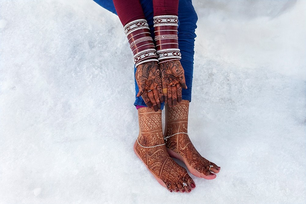 hands feet and snow