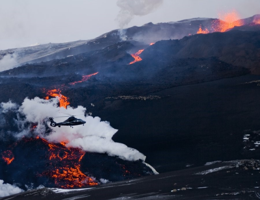 A helicopter flies above Volcano Eyjafjallajokull,
