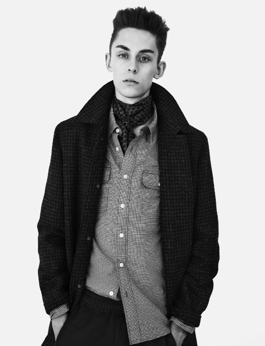 TOBIAS wears coat by APC; shirt by LEVI'S; long-s