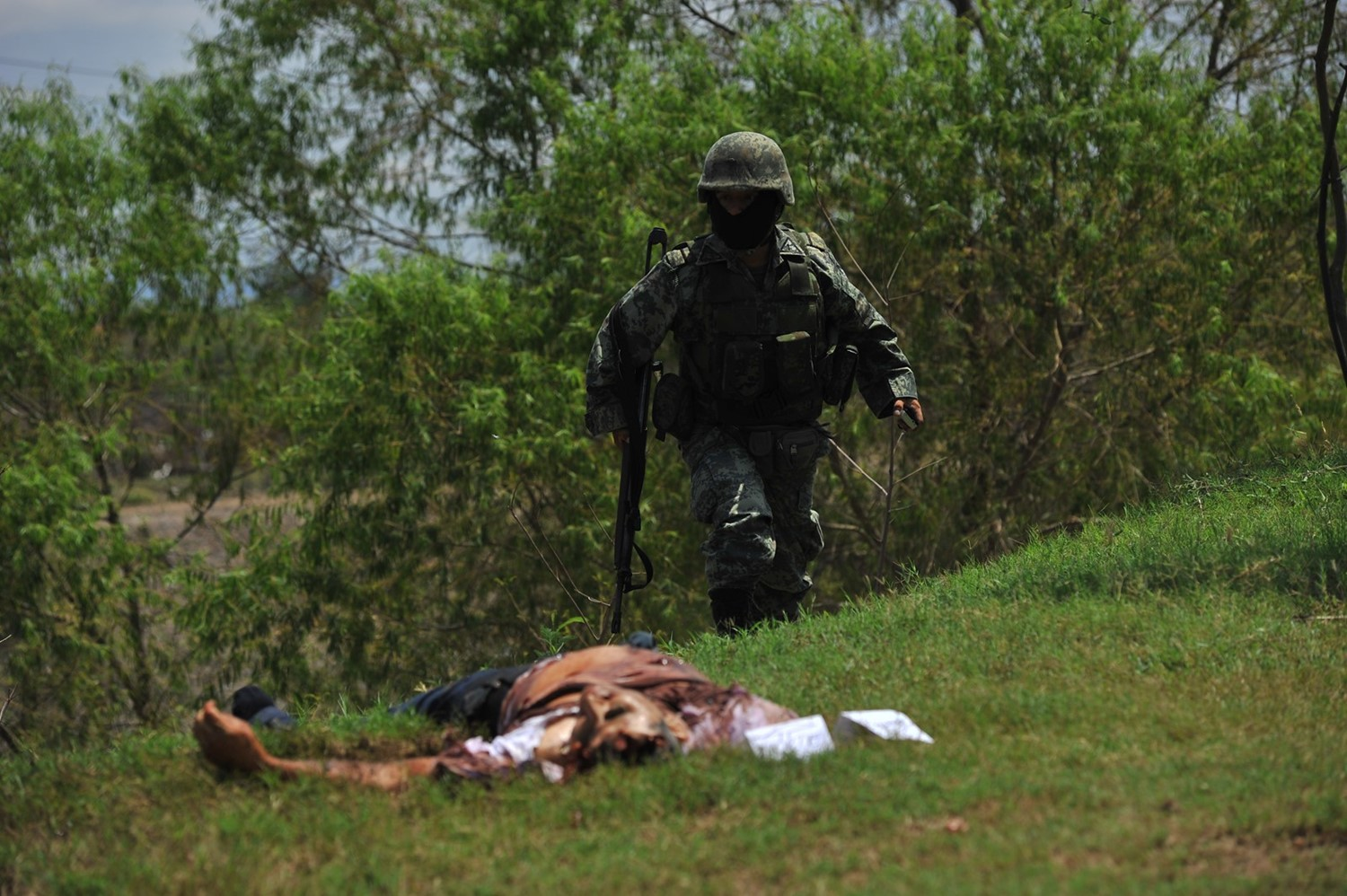 photo 9 - soldier and body