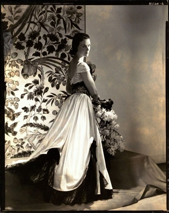 The Countess of Rosse wearing a white satin gown w