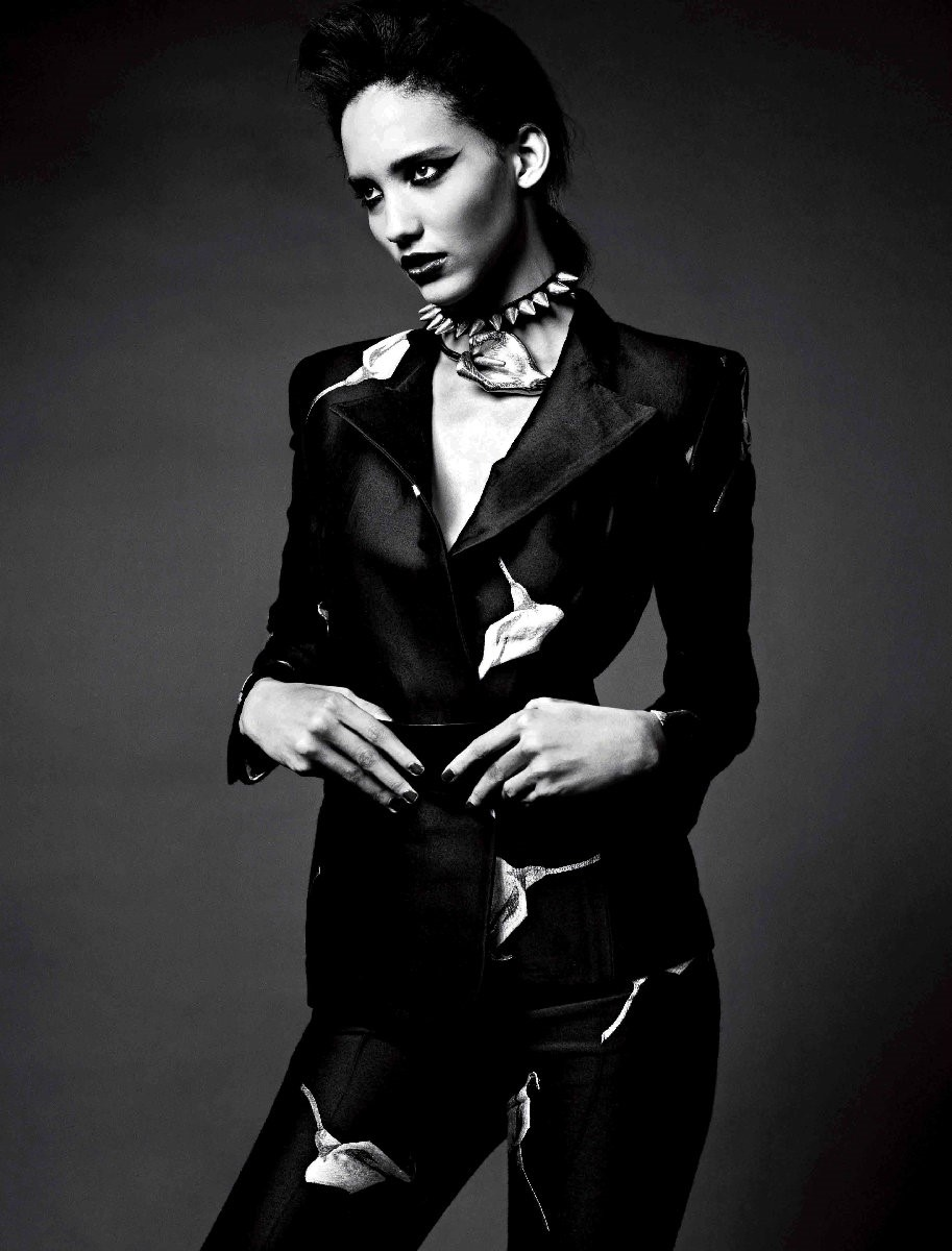 Suit, lily choker and belt by Yves Saint Laurent;