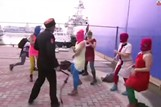 Pussy Riot whipped by Russian cossack security in