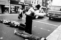 (1) Simon Dack: Activists lie in the road blockin