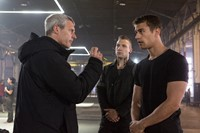Theo James getting notes from director Neil Burger