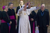 Pope Benedict XVI waves goodbye to crowd on the Va