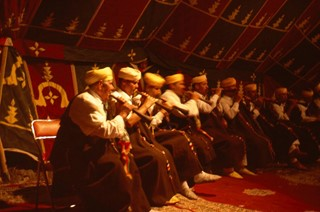 7 MASTER MUSICIAN PIPERS PERFORMING UNDER THE TENT