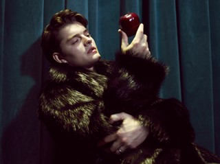 Fur coat by John Galliano; ring Sam Riley's own