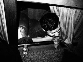 Alex waking up in his new bunk on the outskirts o