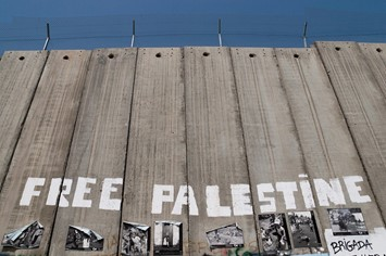 Israel West Bank barrier Free Palestine graffiti