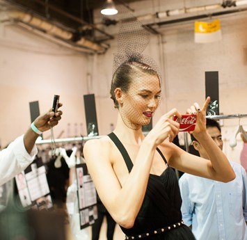 Karlie Kloss taking iPhone Instagram picture backstage