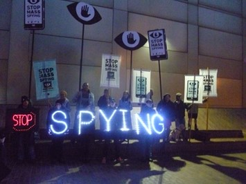 stop spying neon protest