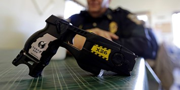 A policeman with a taser