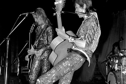 Bowie Mick Rock men in heels