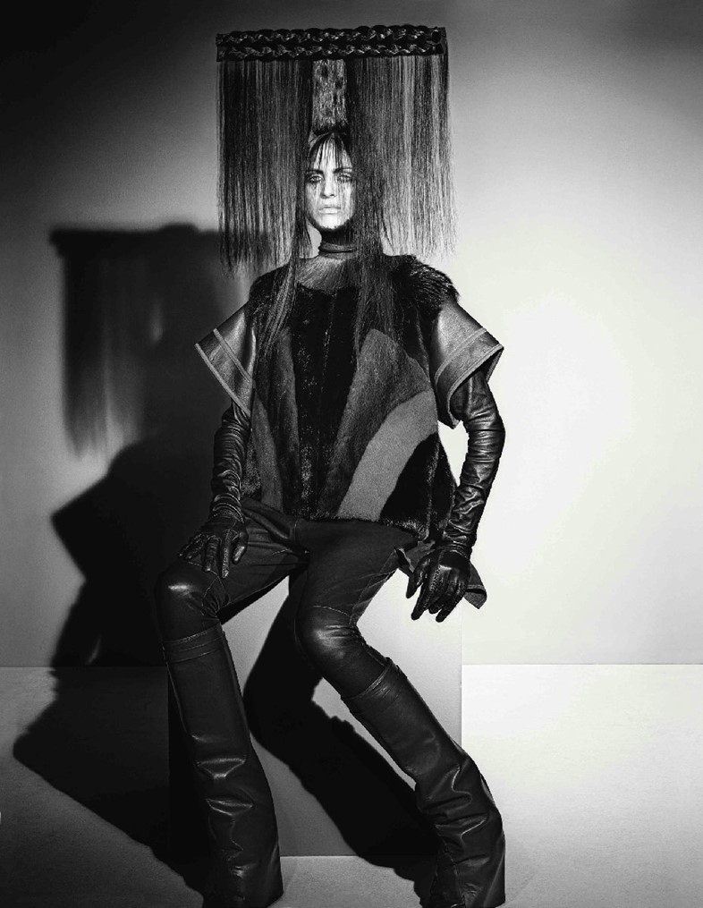 Fur top, leather trousers, gloves and boots all by