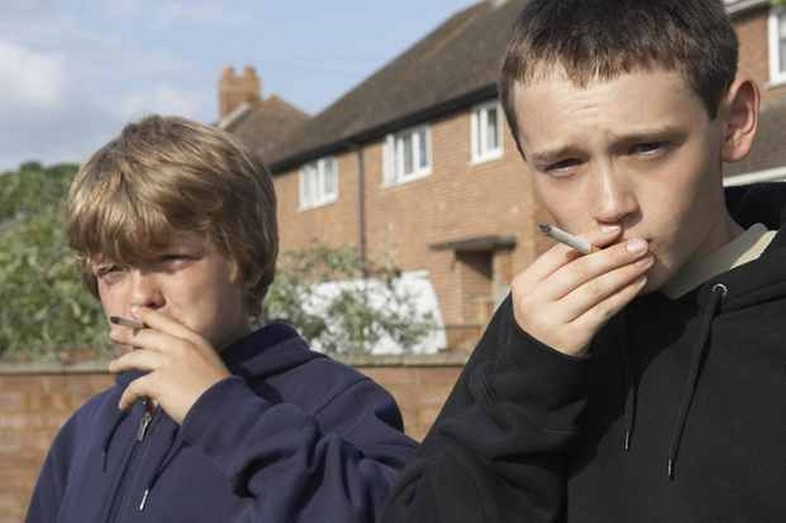 two-boys-smoking-cigarettes-620-204888858