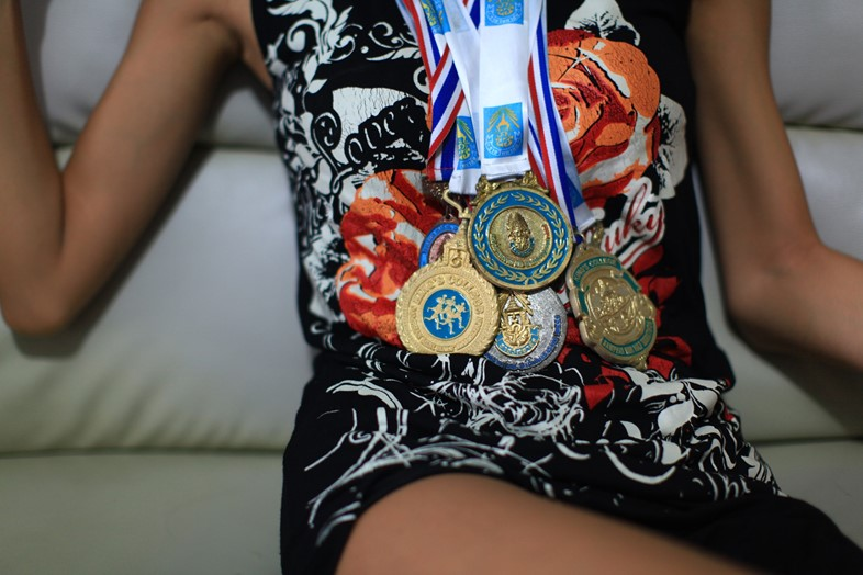 Lolita posing with her running medals