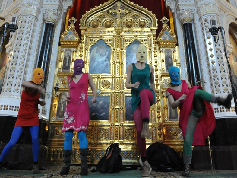 "Members of Pussy Riot perform a ""Punk Prayer"" on the altar of Christ the Savior Cathedral in Moscow in 2012"