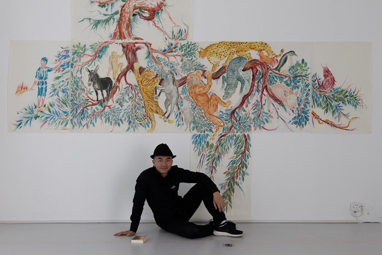 Chinese Artist Wu Junyong in front of his video in