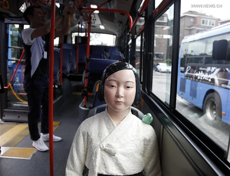Why statues of women are appearing on South Korean buses