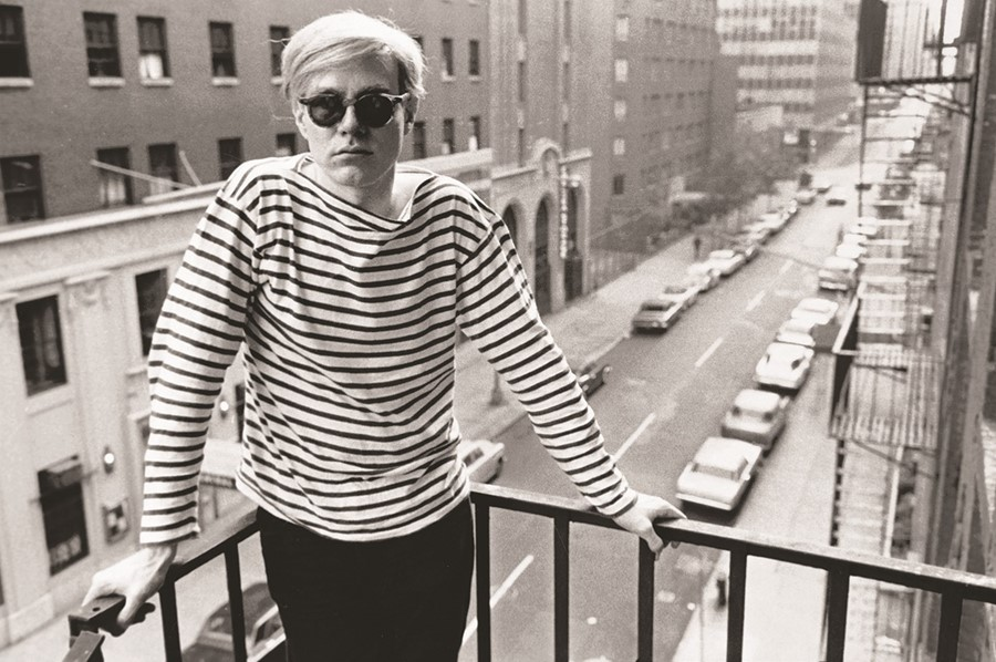 Warhol on fire escape of the Factory, 231 East 47th Street