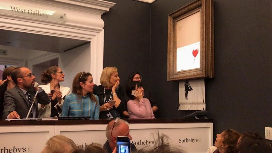 Banksy girl with balloon self destruct Sothebys shredder