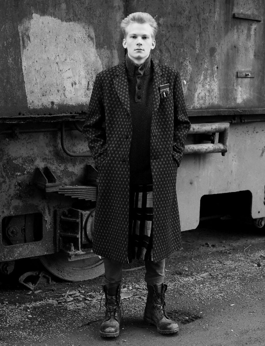 CAMILLO wears coat and pocket accessories by PRADA